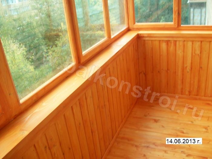 Фото отделки балкона деревом.